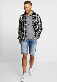 G-Star - 3301 1\2 - Denim shorts - medium aged - 1