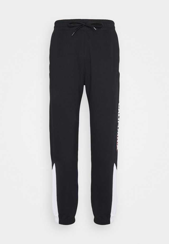 RACING PRINT TREND DROP - Pantalones deportivos - black