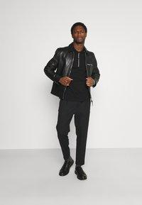 Armani Exchange - Poloshirt - black - 1