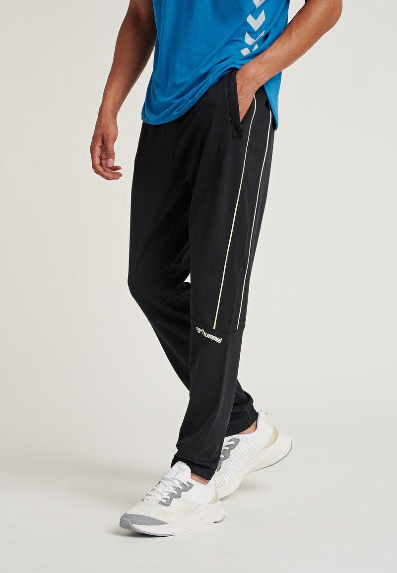Hummel - Træningsbukser - black