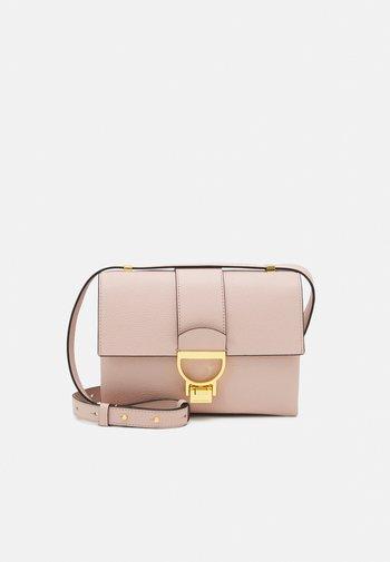 ARLETTIS CROSSBODY - Across body bag - new pink