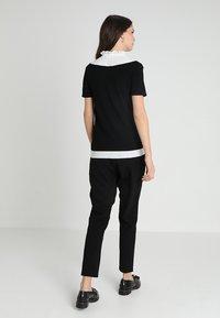 JoJo Maman Bébé - PEGLEG TROUSER - Spodnie materiałowe - black - 2