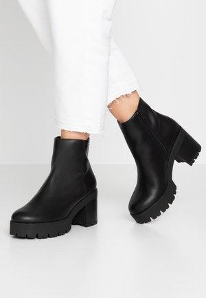 DENIA - Platform ankle boots - black