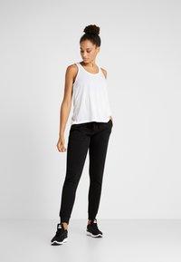 Cotton On Body - GYM TRACKPANT - Pantalones deportivos - black - 1