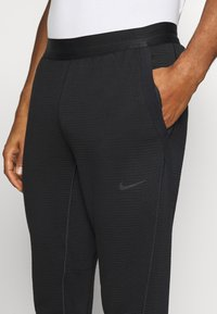 Nike Sportswear - PANT - Tracksuit bottoms - black/anthracite - 4
