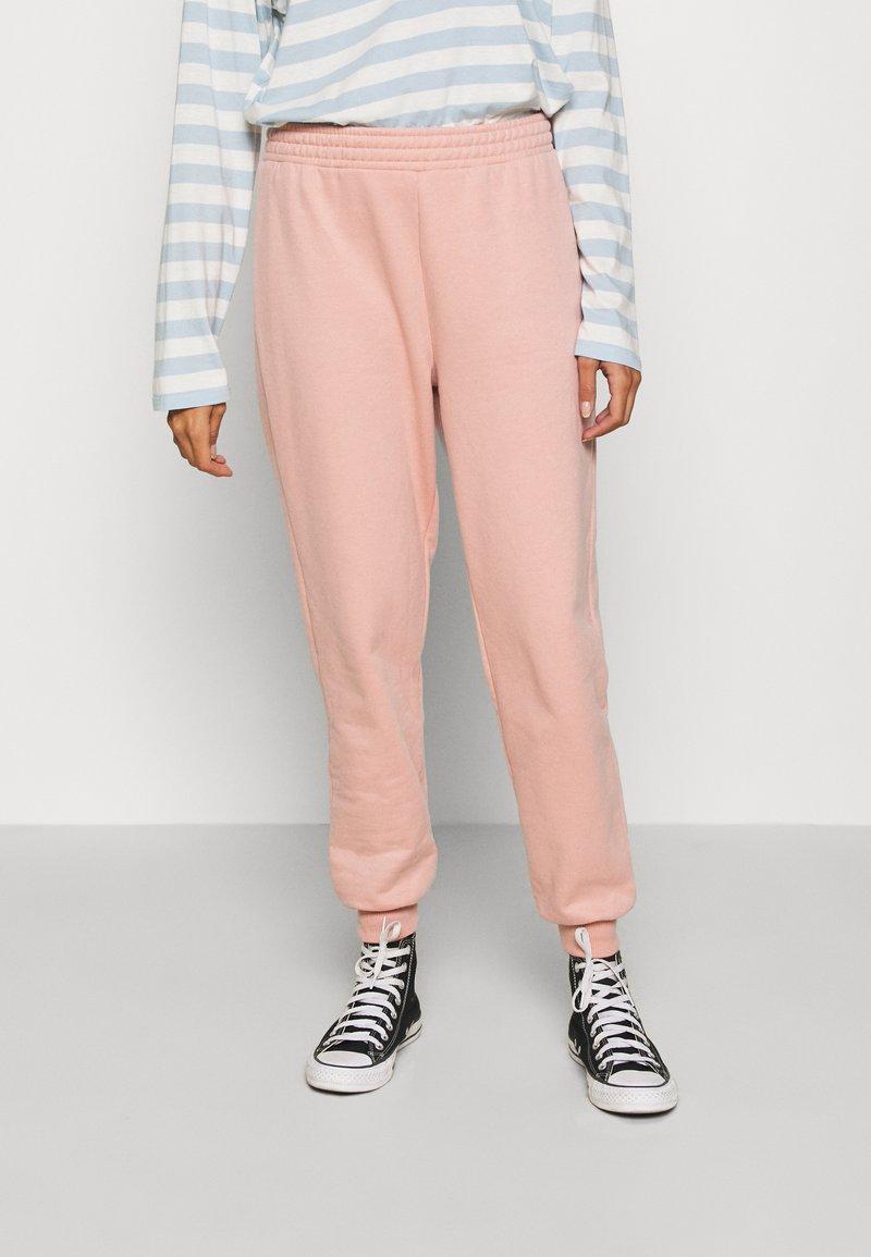 Topshop - SHIRRED WAIST - Tracksuit bottoms - pink