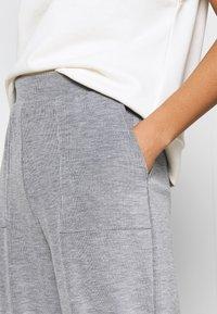 ONLY - ONLDENISE LOUNGE PANT - Tracksuit bottoms - light grey melange - 4
