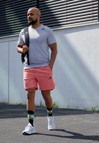 adidas Performance - Sports shorts - seflre - 4