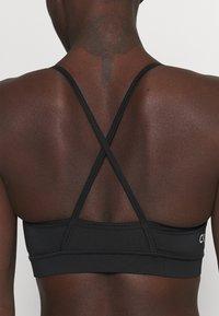 Calvin Klein Performance - LOW SUPPORT BRA - Urheiluliivit: kevyt tuki - black - 4