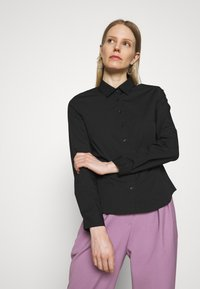 Marks & Spencer London - FITTED SHIRT - Button-down blouse - black - 0