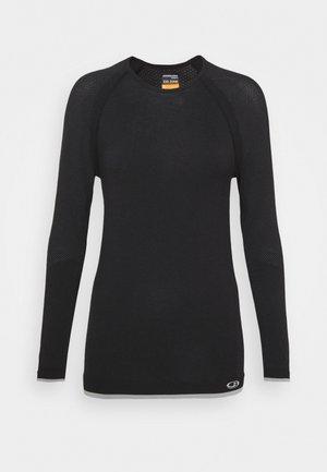 ZONE SEAMLESS CREWE - Long sleeved top - black