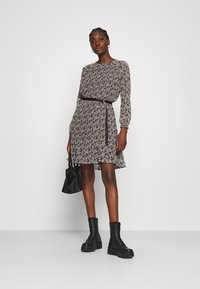 Calvin Klein - PLISSE DRESS - Day dress - black white mini floral print - 1