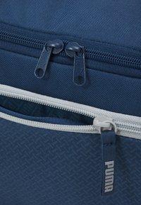 Puma - FUNDAMENTALS SPORTS BAG XS UNISEX - Sports bag - dark denim - 4