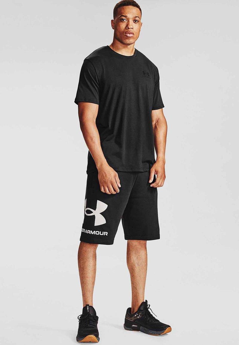 Under Armour - RIVAL BIG LOGO SHORTS - Sportovní kraťasy - black