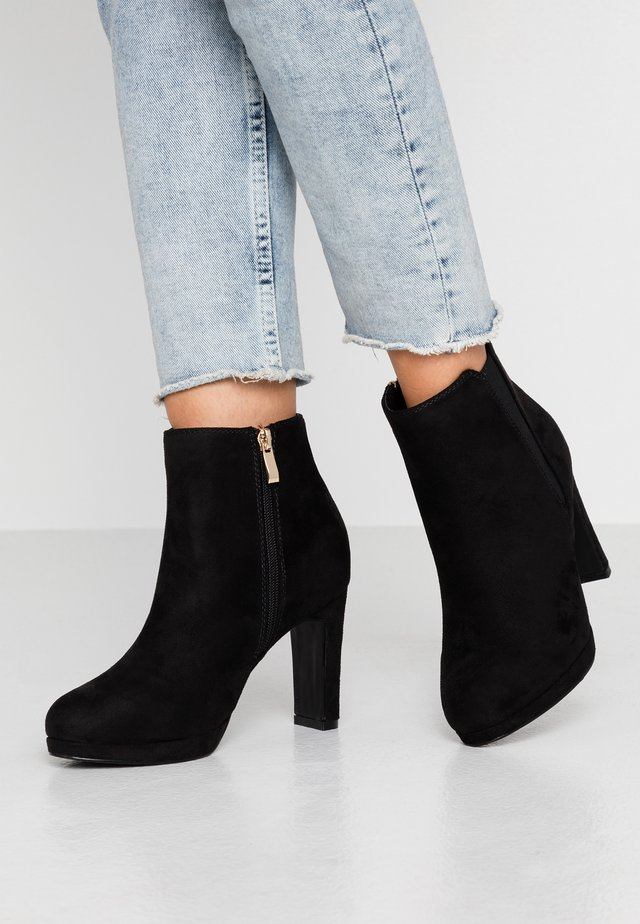 High heeled ankle boots - black