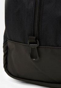 Nike Performance - SHOE 11L UNISEX - Wash bag - black/white - 2