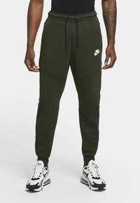 Nike Sportswear - Tracksuit bottoms - sequoia/black - 1