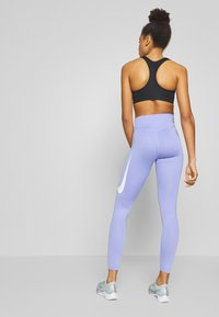 Nike Performance - SWOOSH-RUNNING TIGHT  - Leggings - light thistle - 2