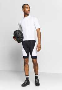 Craft - ESSENCE - T-shirt z nadrukiem - white - 1