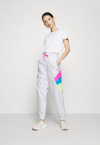 Puma - TRACK PANT - Tracksuit bottoms - white - 1