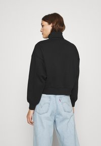 Calvin Klein Jeans - ROLL NECK - Mikina - black - 2