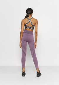 Under Armour - RUSH SEAMLESS ANKLE - Leggings - polaris purple - 2
