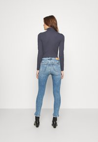 Calvin Klein Jeans - HIGH RISE SKINNY ANKLE - Jeans Skinny Fit - blue twist hem - 2