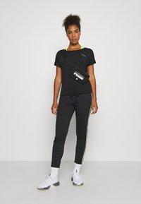 ONLY Play - ONPADELIA TEE - Camiseta estampada - black - 1