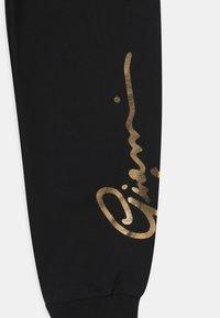 Versace - SIGNATURE UNISEX - Teplákové kalhoty - black/gold - 2