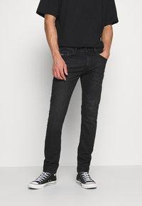 Diesel - THOMMER-X - Slim fit jeans - 069pw - 0