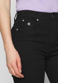 Calvin Klein Jeans - HIGH RISE ANKLE - Skinny džíny - denim black - 5
