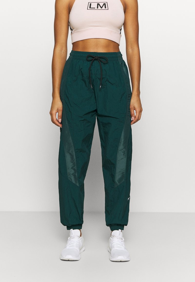 Reebok - PANT - Tracksuit bottoms - dark green