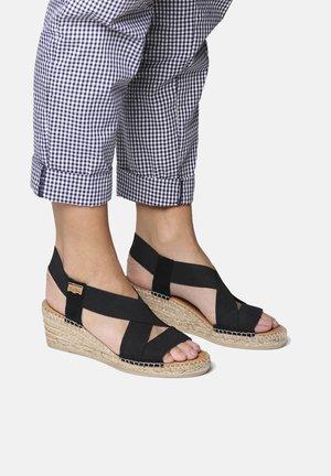 TEIA - Wedge sandals - black