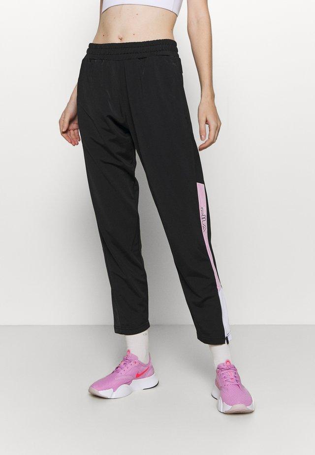 LACI PANTS - Teplákové kalhoty - black