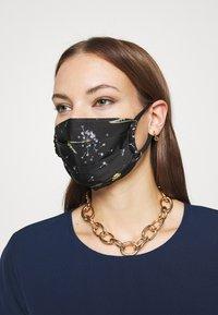 By Malene Birger - DANDELION RAMIA - Community mask - black - 2