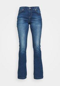 FALLON - Flared Jeans - talia wash