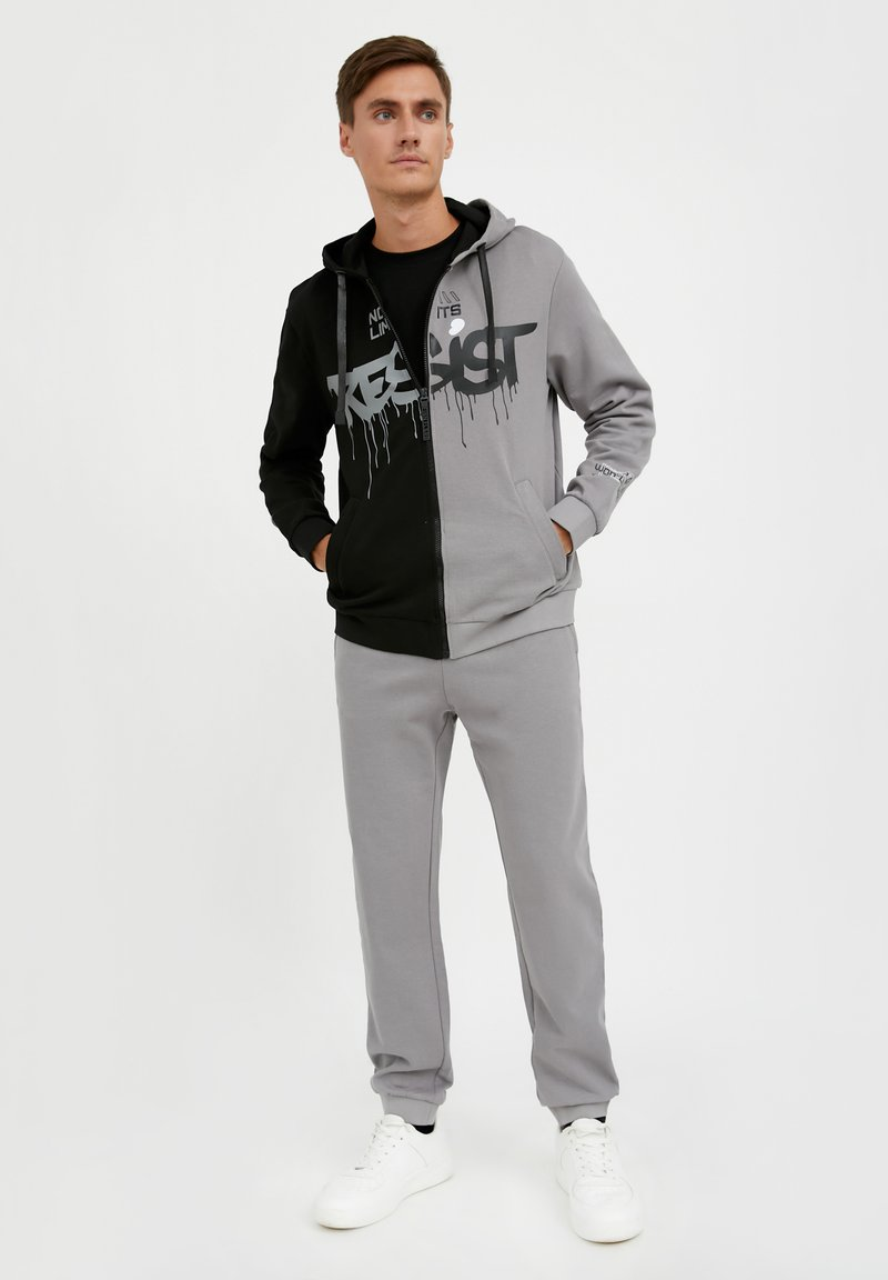Finn Flare - Tracksuit bottoms - grey