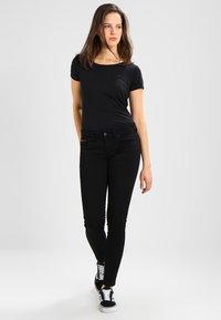Tommy Jeans - HIGH RISE SKINNY SANTANA - Jeans Skinny - dana black stretch - 1