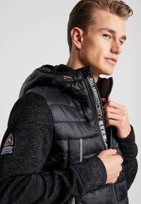 Superdry - STORM FLASH HYBRID - Summer jacket - black heather - 3