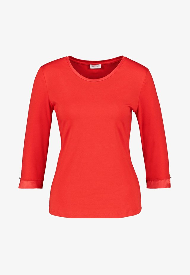 MIT SATINMANSCHETTE - Long sleeved top - red