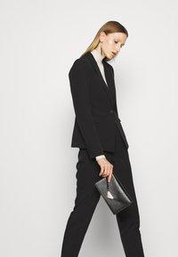 Bruuns Bazaar - RUBY VIGGA PANT - Trousers - black - 4