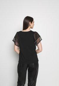 River Island - FRILL DIAMANTE - T-shirts med print - black - 2