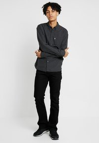 Levi's® - 527™ SLIM BOOT CUT - Jeansy Bootcut - nightshine