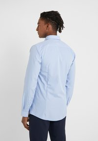 HUGO - ERRIKO EXTRA SLIM FIT - Formal shirt - light/pastel blue - 2