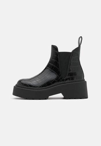 SHADOW - Platform ankle boots - black