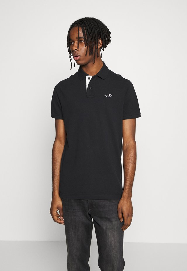 HERITAGE SOLID NEUTRALS - Polo - black
