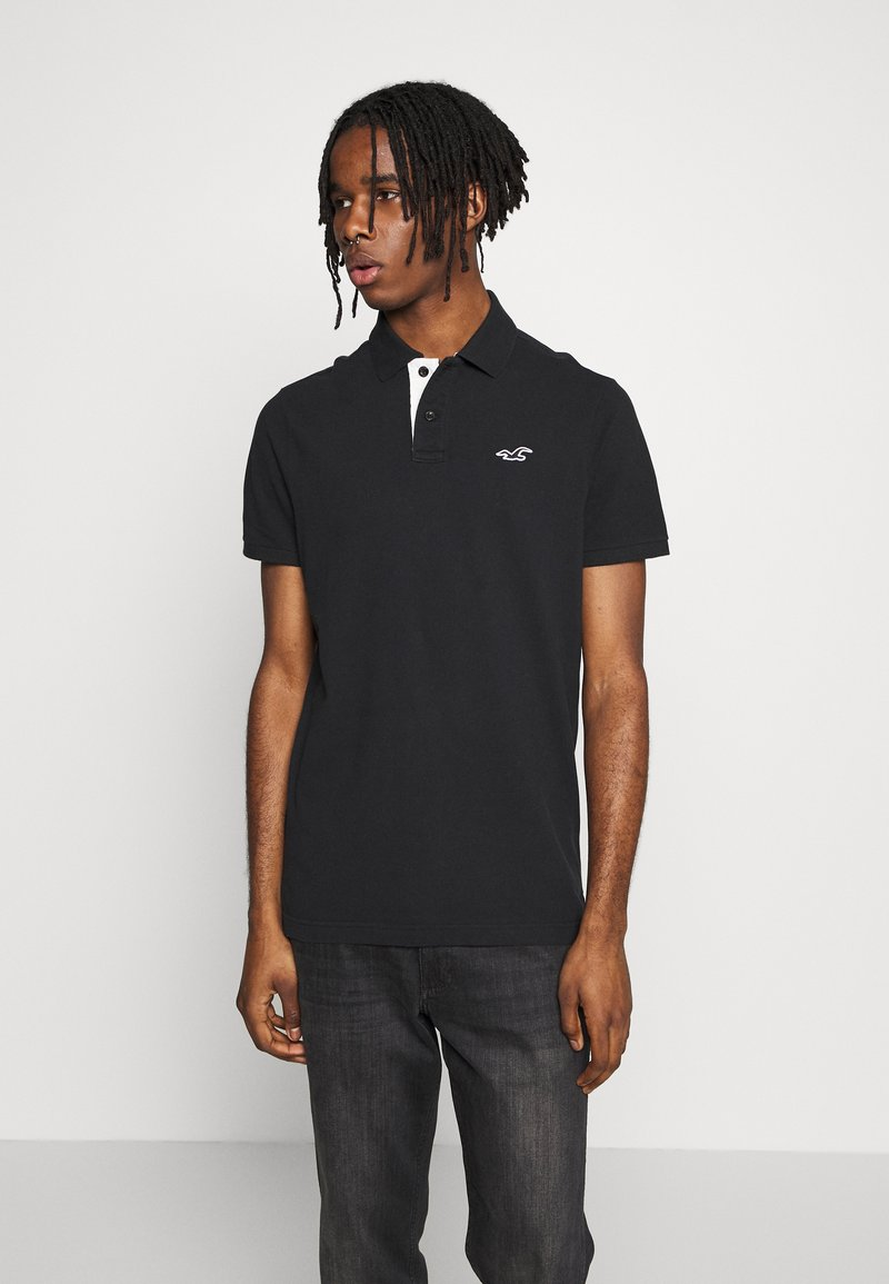 Hollister Co. - HERITAGE SOLID NEUTRALS - Polo shirt - black