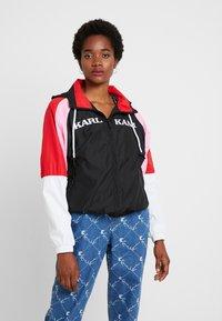 Karl Kani - RETRO BLOCK TRACKJACKET - Windbreaker - black/white/red/pink - 0