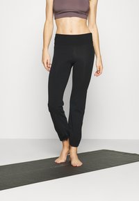 Deha - PANTS - Trainingsbroek - black - 0