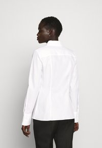 HUGO - THE FITTED - Button-down blouse - white - 2